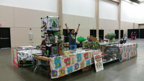 Fugitoid at the final set up of the Cowabunga Corner booth for Fandom Fest 2015