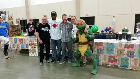 Robbie Rist, Partners in Kryme, Kenn Scott and Nick Palma visiting the Cowabunga Corner Booth.  Leatherhead working the booth.