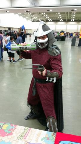 Shredder holding a movie prop from TMNT 2 - Ooze Canister at the Cowabunga Corner booth on Friday.